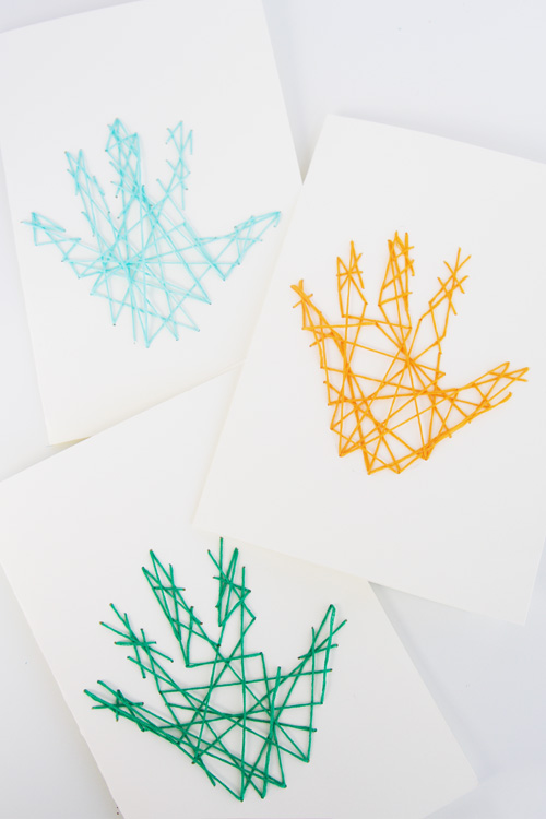These handprint string art cards are so perfect for Mother's Day or Father's Day! You will want to make this adorable keepsake craft this year!