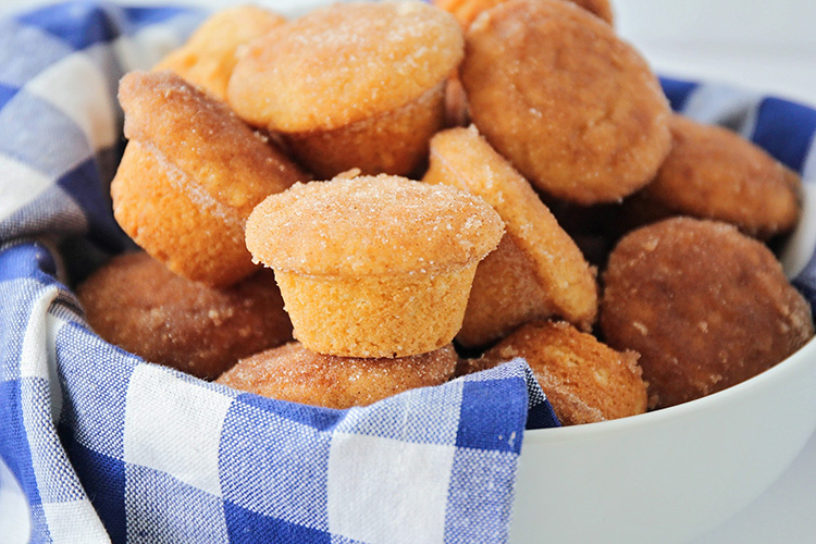 These bite-sized cinnamon sugar mini muffins are so sweet and delicious! They're so light and fluffy, and dipped in cinnamon sugar for extra flavor!