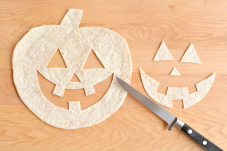 These jack-o-lantern cheese quesadillas are SO FUN and so simple to make! They're such a fun and easy Halloween food idea and would be great as an easy Halloween dinner! Not to mention they're fantastic for picky eaters!