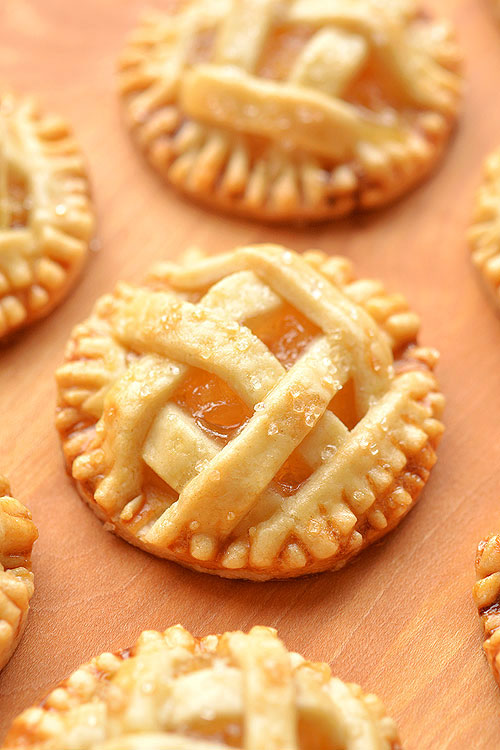 These mini apple pies are SO GOOD! There's nothing like warm apple pie, with a delicious flaky crust and that gooey, sweet apple filling. These delicious fall treats will disappear fast!