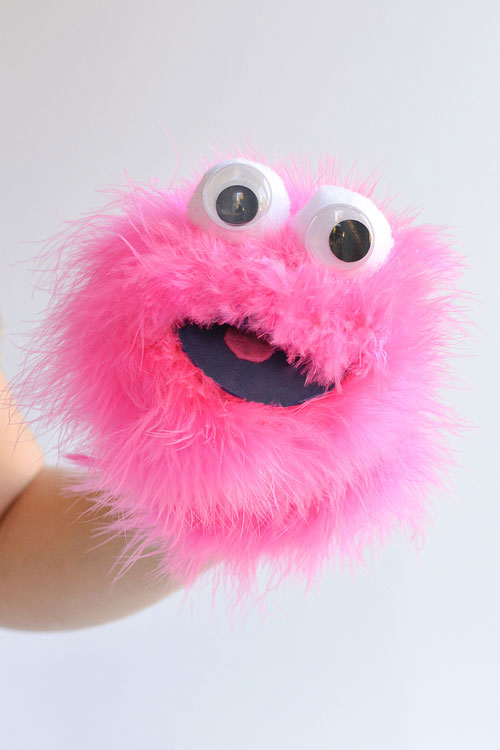 This easy feather boa sock puppet is SO CUTE! And it's so simple to make! Just wrap a feather boa around a fuzzy sock and you end up with the happiest looking sock puppet that's guaranteed to make everyone smile!