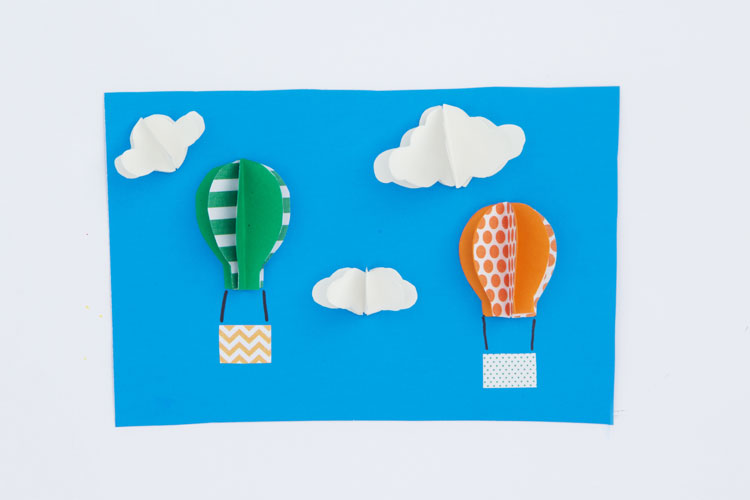 These 3D paper hot air balloons are SO adorable and easy to make! You will love turning this into a handmade paper card that is sure to impress anyone!