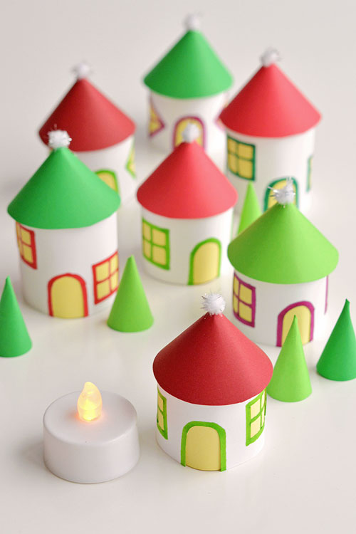 40+ Easy Christmas Crafts for Kids - Twinkling Paper Roll Christmas Village