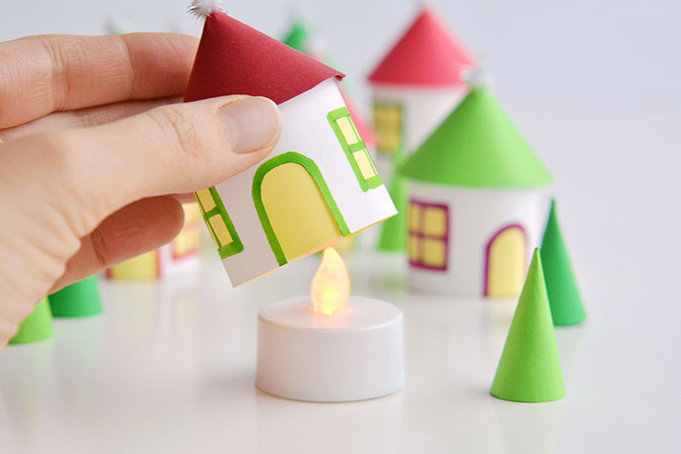 This paper roll Christmas village is SO CUTE and it's really easy to make! Add a few battery operated tea lights and you can create a magical glowing village. This is such a cute Christmas decoration and a super fun Christmas craft to make with the kids.