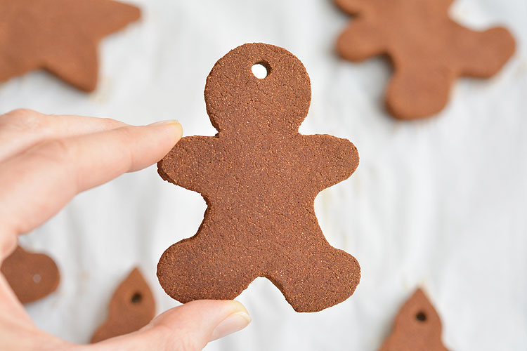 These cinnamon ornaments smell SO GOOD and they're really simple to make! Only 3 ingredients and they give you that amazing Christmas baking smell! You can hang them on the Christmas tree as is, or decorate them with puffy paint. Such a fun Christmas craft!