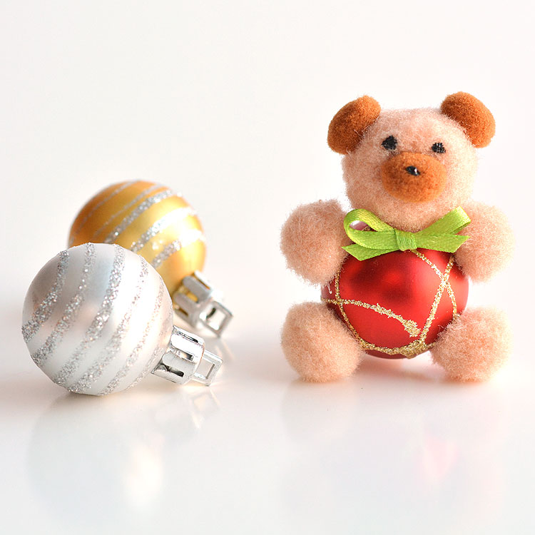 These pom pom teddy bear ornaments are ADORABLE for Christmas and they're super easy to make! All you need are dollar store pom poms and Christmas ball ornaments. This is such a fun dollar store kids craft idea for Christmas and a cute idea for homemade Christmas ornaments!Cutest little teddy bears ever!