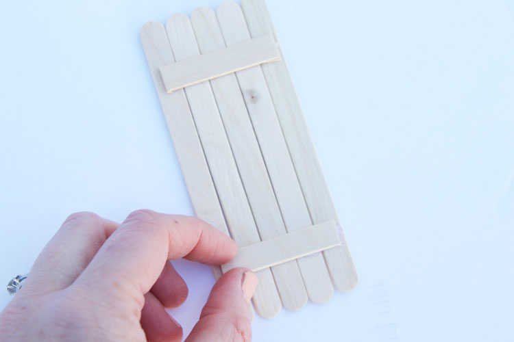 These popsicle stick door ornaments are SO cute and such an easy kids ornament craft to make!