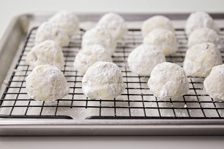 These melt-in-your-mouth delicious snowball cookies are so easy to make and only have six ingredients! They are the perfect holiday cookie!