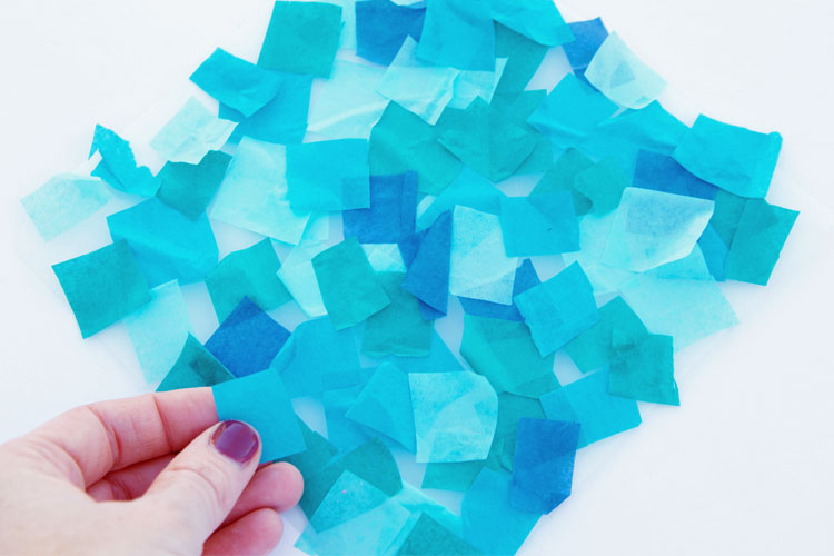 These snowflake suncatchers are so fun to make and are such a beautiful twist on paper snowflakes!