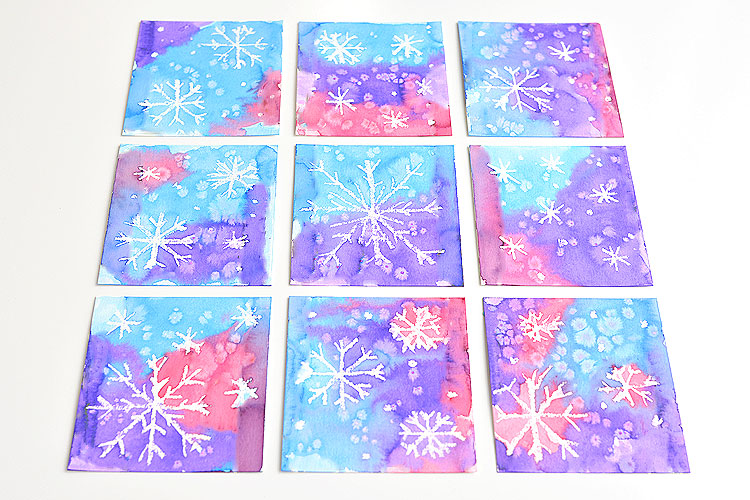 "This magic salt and watercolor snowflake art project for kids is so much fun! The snowflakes magically appear when you add the paint and the salt makes the painting look ""frosty"". This is such a cool process art idea for kids that's fantastic in the classroom at school or on a snowy day at home this winter!"
