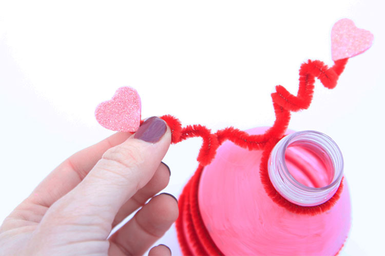 Create love bugs for Valentine's Day using water bottles and glow sticks. They are SO fun to play with in a dark room!