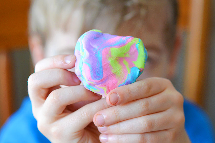 This edible frosting play dough makes PERFECT play dough! And with only 2 ingredients it's really easy to make! The recipe makes super soft dough that's easy to work with and it's completely safe to eat - and there's no cooking involved! Made with store bought icing, it's a super simple activity for the kids to try!