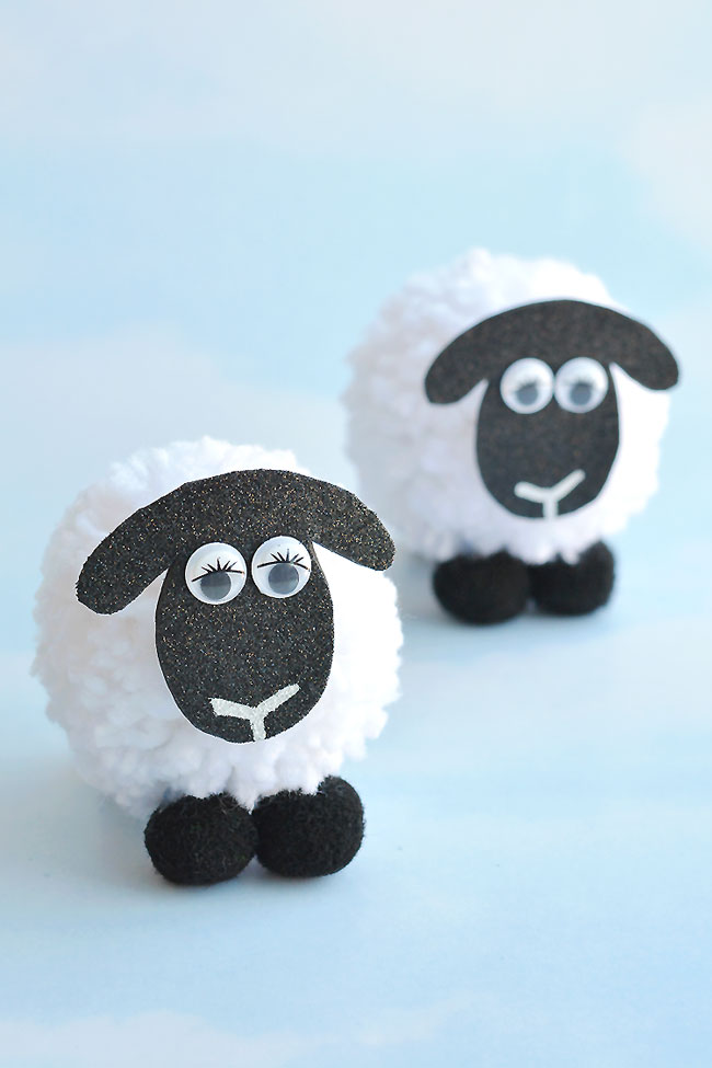 These pom pom sheep are SO CUTE and they're really simple to make! It's so easy to make DIY pom poms from yarn just by using your hands! This is such a fun kids craft for spring, or even Easter! I love that it uses such simple craft supplies. Pom pom crafts are the best!