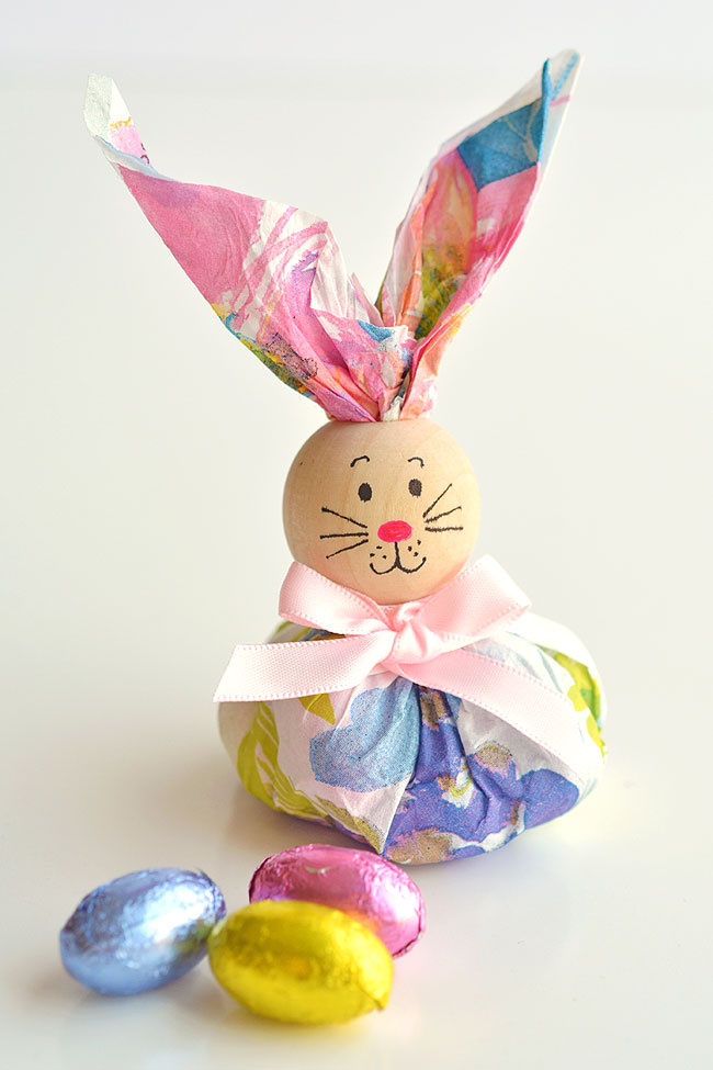 These paper napkin bunny favors are SO CUTE! And they're really easy to make! With dollar store paper napkins and foil covered eggs you can make adorable Easter treats to give away to the kids, grandkids or even to the classroom at school! They'd even make super cute decorations for the Easter table. This is such a fun and simple Easter craft idea.