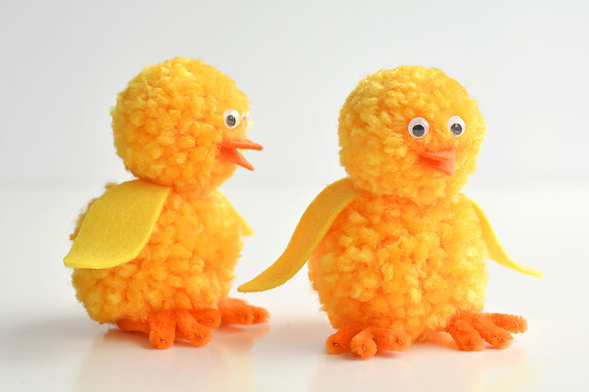 These pom pom chicks are SO CUTE for spring time! This is such a cute Easter craft idea for kids! They'd look super cute as a decoration on the Easter table, or just a festive spring craft to make with the kids on a rainy day. You don't need any special tools to make the DIY pom poms, just your hands! Each one takes less than 15 minutes to make using simple craft supplies. The kids will love playing with them when you're done!