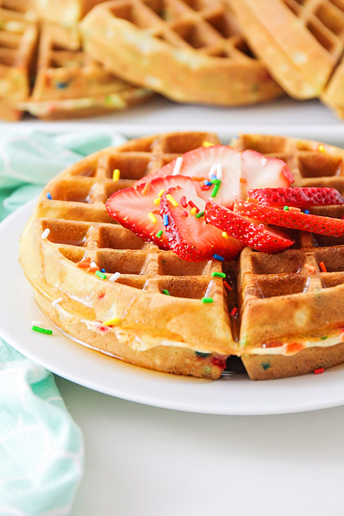 These cake batter waffles taste just like birthday cake, but in waffle form! They're perfect for birthdays, or just any time you need a special breakfast!