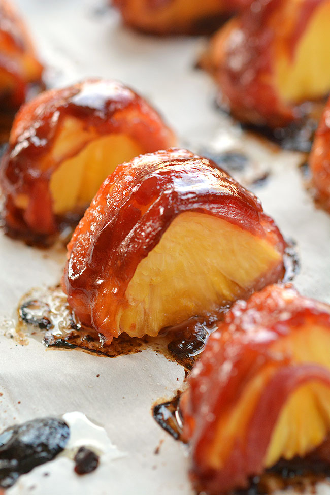 These bacon wrapped pineapple bites are SO GOOD!! And they're so easy to make! This is such an easy appetizer and a great three ingredient recipe that you can throw together at the last minute. The bacon and the pineapple taste sooooo good together! Mmmm... bacon!