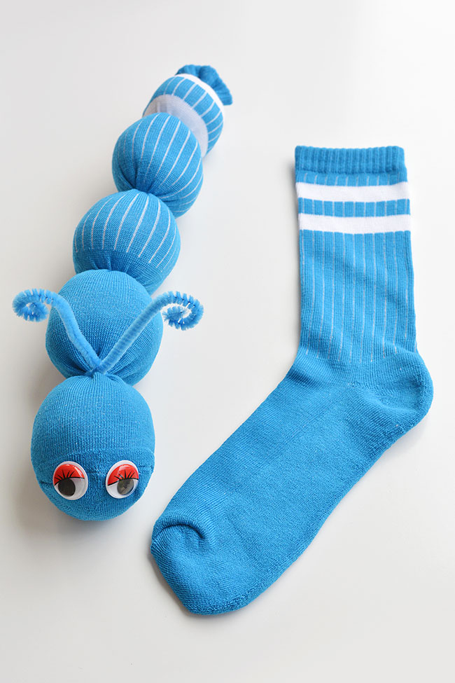 These no-sew sock worms are SO EASY to make and the kids love them! Or maybe they're sock caterpillars? Either way, this is such a fun kids craft and it's easy enough that the kids can actually make it themselves. It takes less than 10 minutes to make each one using just a few simple supplies from the dollar store. Such a fun way to use those mismatched socks!