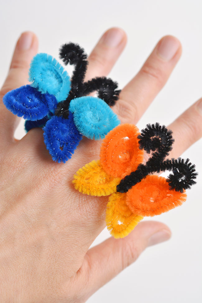 These pipe cleaner butterfly rings are SO SIMPLE to make and they're so pretty! This is such a fun and easy kids craft idea and a super fun summer craft. All you need are a few pipe cleaners and in less than 5 minutes you can make an awesome homemade ring!