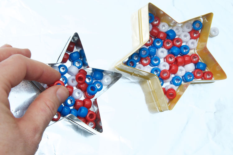 These melted bead stars are a great kids craft for the Fourth of July! Make them to add to your patriotic decor or just for an easy summer craft!