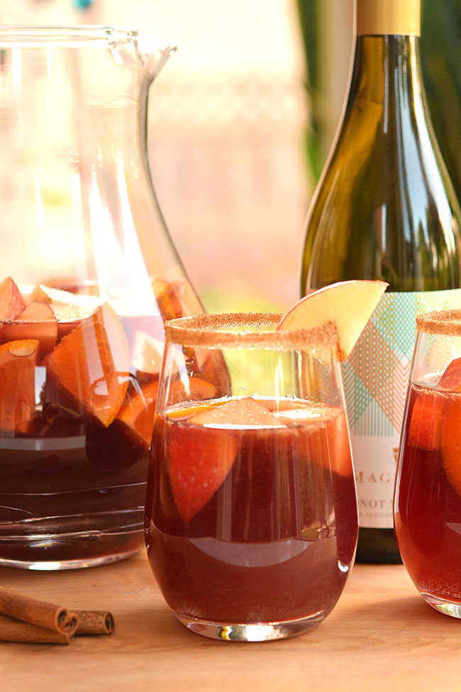 This recipe for autumn sangria is SO GOOD! Infused with apples and cinnamon, this simple red wine sangria recipe is fruity, festive and tastes delicious!