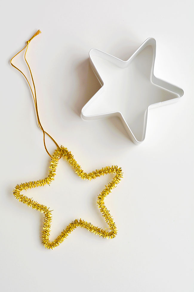 Easy star pipe cleaner ornaments using a star cookie cutter as a guide