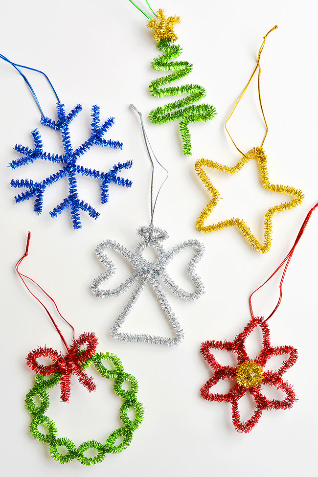 These snowflake pipe cleaner ornaments are so COOL and they're really simple to make. You only need 2 pipe cleaners! This is such an easy Christmas craft that you can make in less than 5 minutes using dollar store supplies. Such a fun Christmas activity for kids and a great way to make homemade Christmas ornaments! Be sure to check out the other 5 tutorials in this series for more pipe cleaner ornaments that go along with this frosty snowflake!