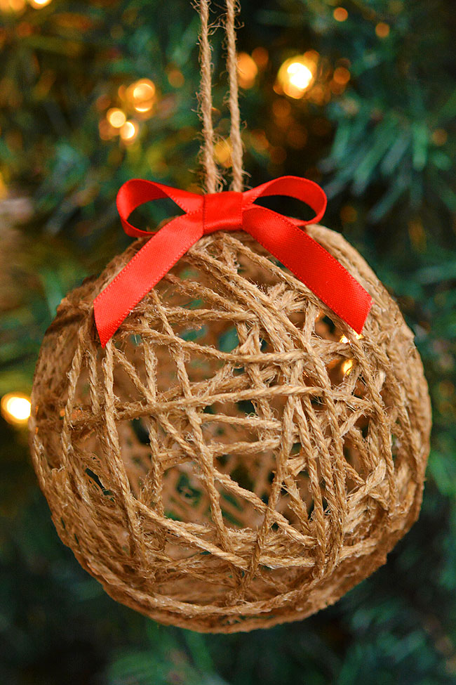 DIY twine ball ornaments are so FUN to make and add such rustic charm to your tree! What a fun homemade Christmas craft the whole family can enjoy together!