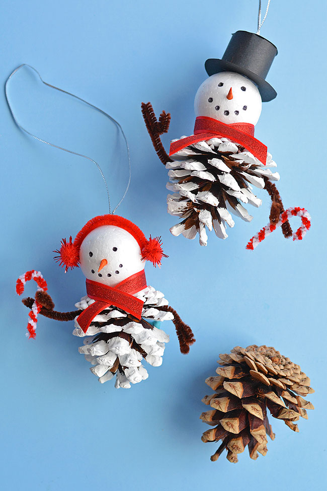 40+ Easy Christmas Crafts for Kids - Pinecone Snowman Ornaments