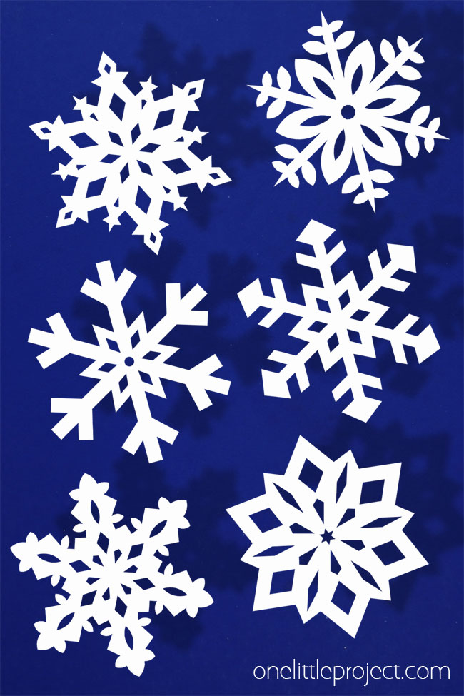 Paper snowflakes are SO SIMPLE and super inexpensive to make! It's easy to make beautiful and perfect looking snowflakes every single time!