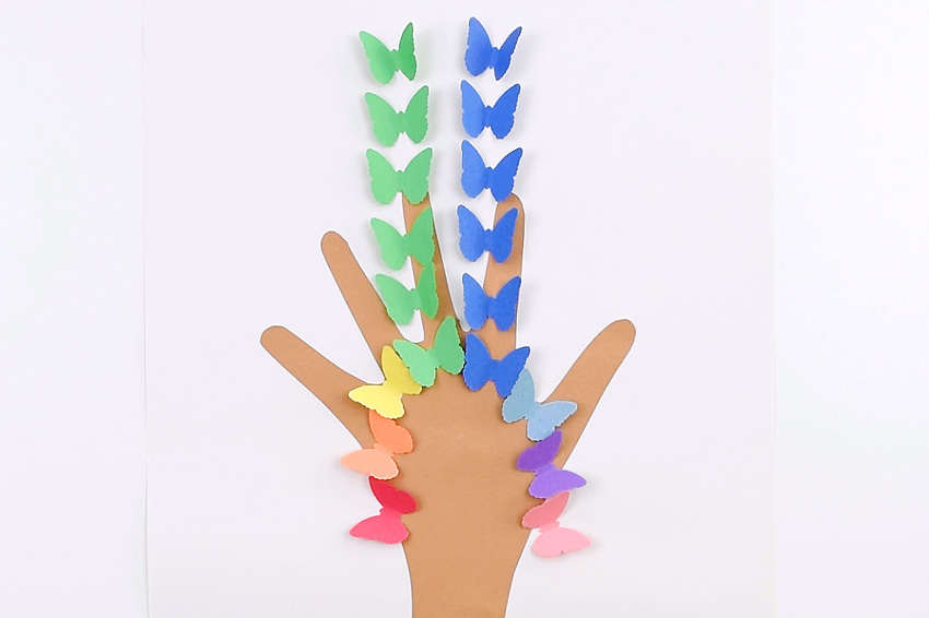 Handprint Butterfly Tree Made From Construction Paper - Start by building the middle two rows and work your way outward.