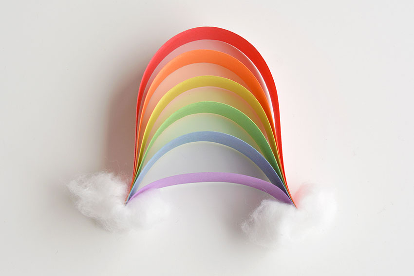 Paper Strip Rainbows - Finished paper rainbow with two fluffy clouds.