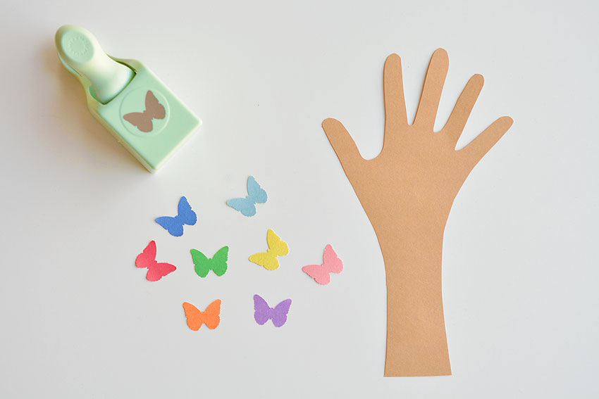 Handprint cutout and paper punched butterflies