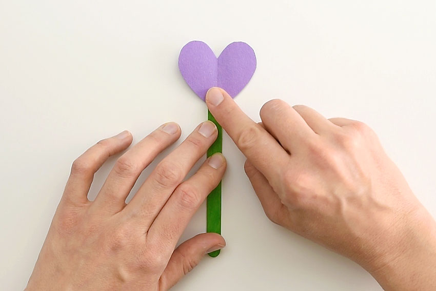 Paper Heart Flowers - Press a heart onto the glue to start the flower.