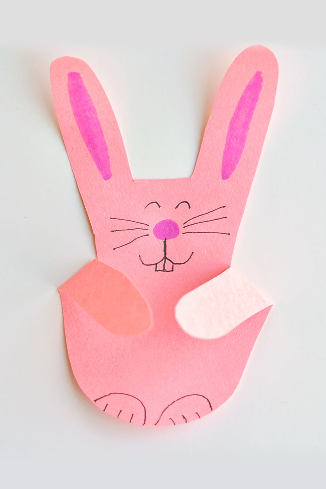 These handprint bunnies are SO CUTE and they're so easy to make!! This is such a simple construction paper craft and a great craft for kids. Trace a handprint and make these bunnies for Easter or anytime. Such a fun activity for bored kids that needs barely any supplies!