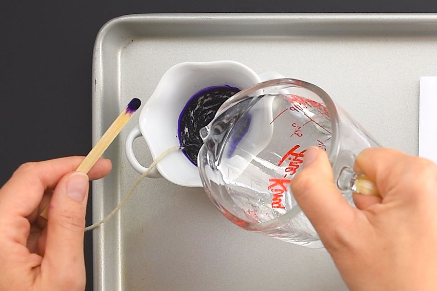 Pouring water into a bowl of paint