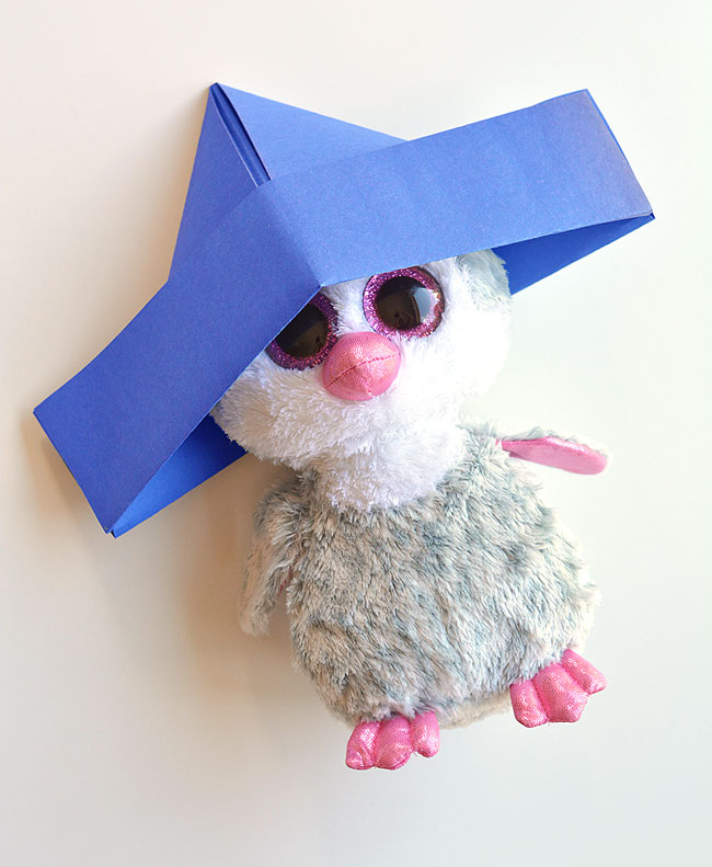 Hat made out of paper on stuffed animal